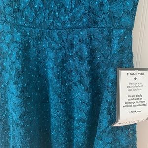 A mermaids dream! Teal colored sparkle dress!
